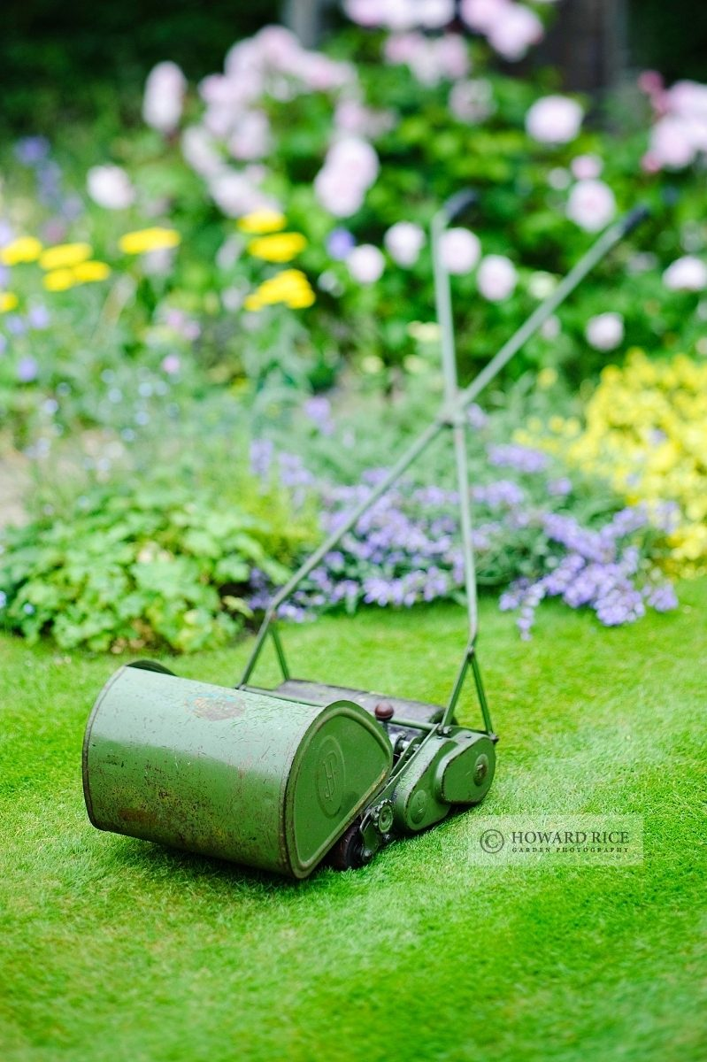 Vintage hand pushed cylinder mower with grass box made by JP Lawnmowers, June