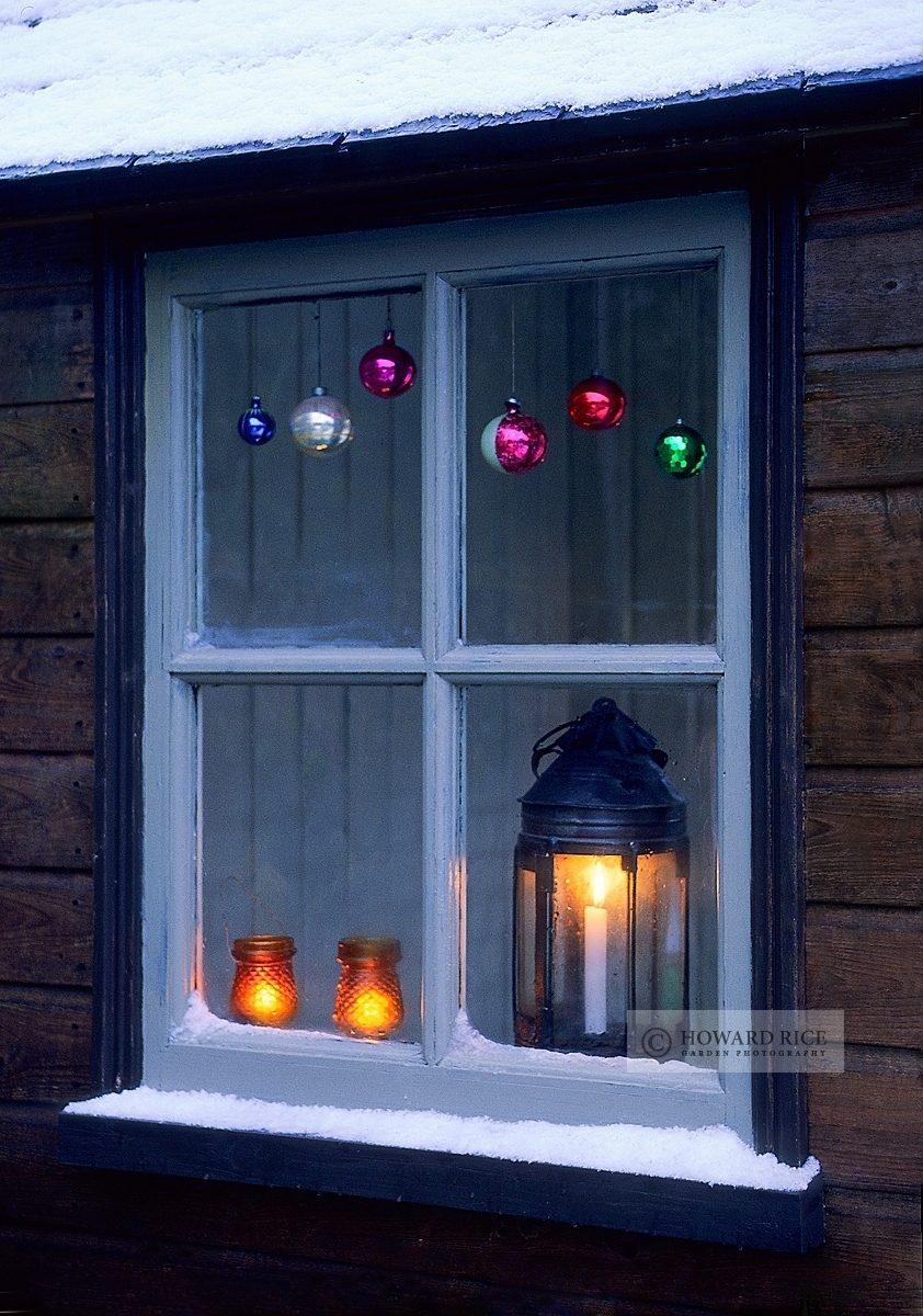 Vintage lantern on window ledge in winter