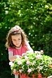 girl tending bedding plants